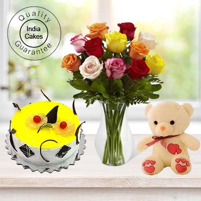 Eggless Pineapple Cake Half Kg with 6 Mix Roses Bunch and a Teddy Bear