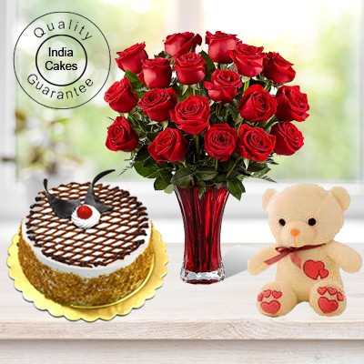 Eggless Butterscotch Cake 1.5 Kg with 6 Red Roses Bunch and a Teddy Bear