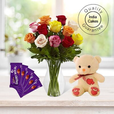 6 MIX FLOWERS BUNCH,1 TEDDY BEAR AND 5 ASSORTED CADBURY CHOCOLATES