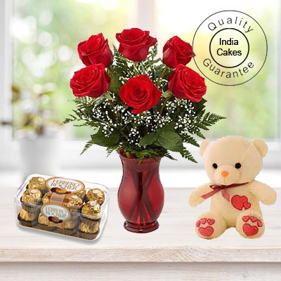 6 RED ROSES BUNCH , 16 PCS FERRERO ROCHER CHOCOLATES AND 1 TEDDY BEAR