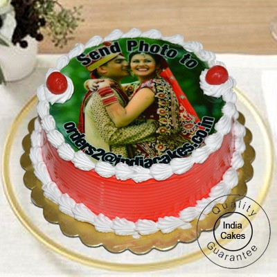 1 Kg Eggless Strawberry Photo Cake with 12 Red Roses Bunch