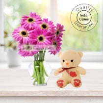 12 PINK GERBERAS BUNCH AND 1 TEDDY BEAR