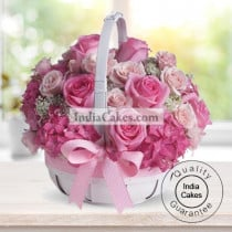 50 PINK ROSES ARRANGED IN A BASKET