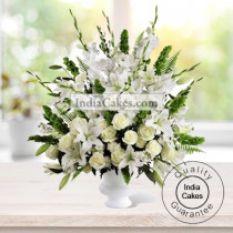 ARRANGEMENT OF LILIES, ANTHURIUMS, ORCHIDS, ROSES AND CARNATIONS ( ALL WHITE FLOWERS )