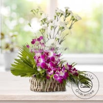 ARRANGEMENT OF ORCHIDS AND CARNATIONS