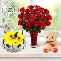 Eggless Pineapple Cake 1.5 Kg with 6 Red Roses Bunch and a Teddy Bear