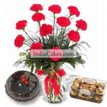 10 Red Carnations Bunch And Half Kg Black Forest Cake With16 Ferrero Rochers Chocolates