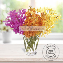 10 EXQUISITE ORCHIDS ARRANGED WITH A GLASS VASE