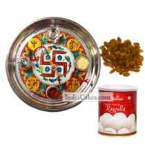 Golden Thali With Green Design And Rasgulla And Raisins
