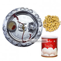 Silver Thali And Rasgulla And Cashew