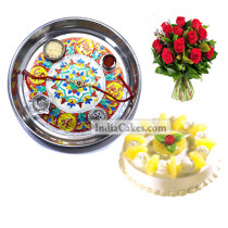 Silver Thali With Design And Half Kg Eggless Pineapple Cake And 10 Red Roses Bunch