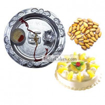 Silver Thali And Half Kg Eggless Pineapple Cake And 250 gms Pista Dryfruits