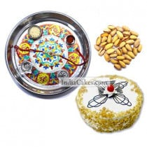 Silver Thali With Design And Half Kg Eggless Butterscotch Cake And 250 gms Pista Dryfruits