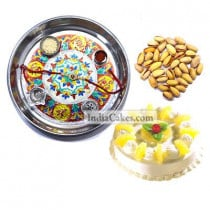 Silver Thali With Design And Half Kg Eggless Pineapple Cake And 250 gms Pista Dryfruits