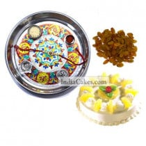 Silver Thali With Design And Half Kg Eggless Pineapple Cake And 250 gms Raisins Dryfruits