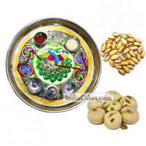 Golden Thali With Green Design And Pedha With Pista Dryfruits