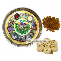 Golden Thali With Green Design And Pedha With Raisins Dryfruits