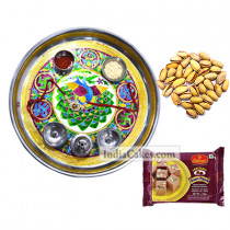 Golden Thali With Green Design And Soanpapdi And Pista