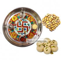 Golden Thali With Red Design And Pedha With Pista Dryfruits
