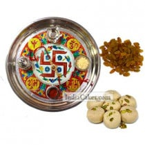 Golden Thali With Red Design And Pedha With Raisins Dryfruits