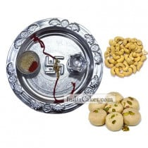 Silver Thali And Pedha With Cashew Dryfruits