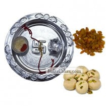 Silver Thali And Pedha With Raisins Dryfruits