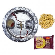 Silver Thali With Design And Soanpapdi And Cashew