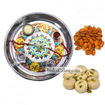 Silver Thali With Design And Pedha With Almond Dryfruits