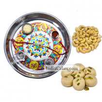 Silver Thali With Design And Pedha With Cashew Dryfruits