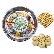 Silver Thali With Design And Pedha With Pista Dryfruits