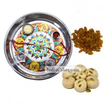 Silver Thali With Design And Pedha With Raisins Dryfruits